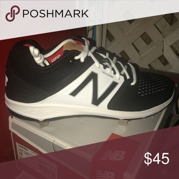 New balance metal Spikes size 10 New in box men's new balance metal spikes.  White and black New Balance Shoes Athletic Shoes