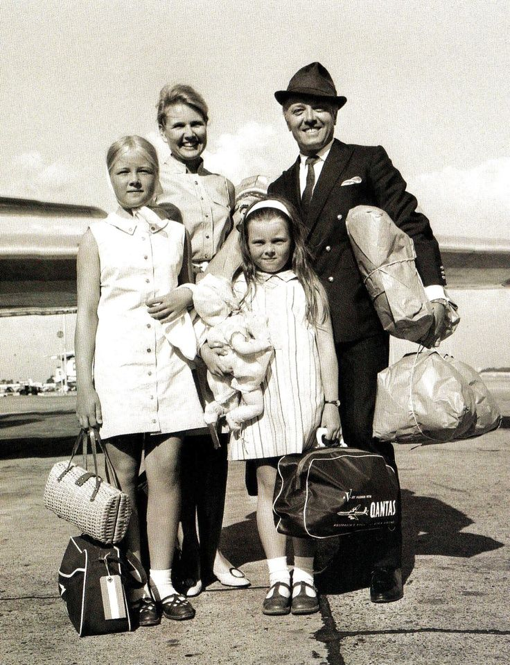 Laden with parcels, actor Richard Attenborough is seen with his wife, actress Sheila Sim, and daughters Jane, 12 and Charlotte, 8, after flying into into Heathrow Airport, London, on their return from a Mediterranean holiday - 6 September 1967