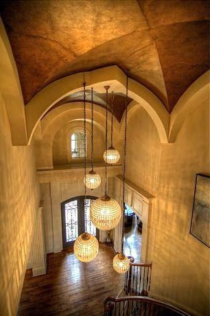 Mediterranean Entryway with Hardwood floors, Grand entryway #chandelier #foyer #homedesign