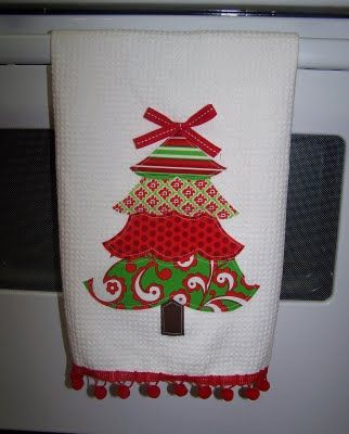 Christmas kitchen towels.  Cute idea to use up old fabric scraps.