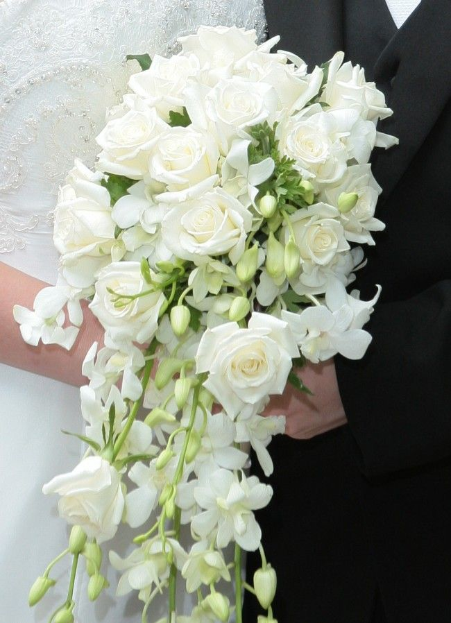 Cascade bridal bouquet of white roses and dendrobium orchids