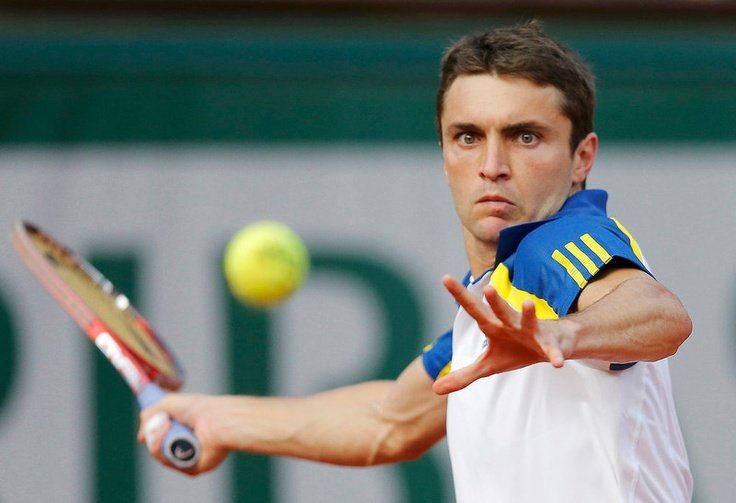 Gilles Simon of France hits a return to Roger Federer of Switzerland during their mens singles match at the French Open tennis tournament at the Roland Garros stadium in Paris June 2, 2013. REUTERS/Gonzalo Fuentes