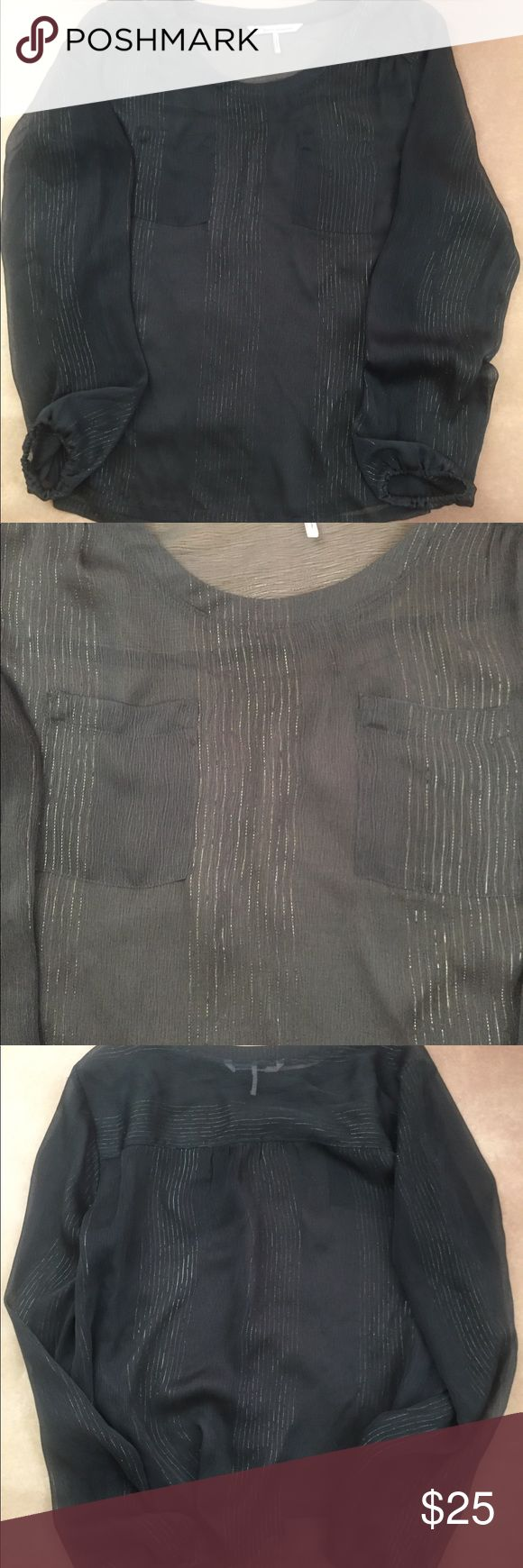 "French Connection Sheer Gray Top Large Pre-owned French Connection Sheer Gray Top Large in very good condition. Very light and feminine with two pockets on upper front, side slits and metallic gold shimmer threads.  Sleeves are gathered with elastic.  Approximate measurements laying flat: Bust - 22-1/2"" Shoulder seam to shoulder seam - 16"" Length 25""  No holes, rips or stains.  Smoke free environment.    Thank you for looking.  EPM1-B69-1-118 French Connection Tops"