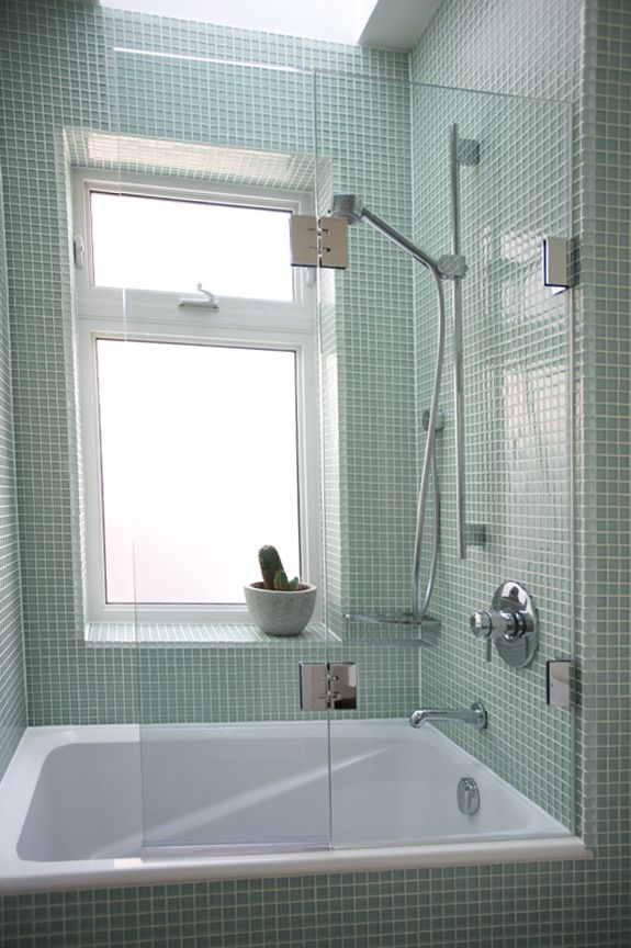 I'm really loving the soothing, oceany colors and glass-frameless-shower look lately!
