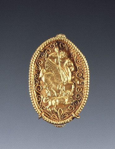 Ring with Bellerophon Spearing the Chimaera,Santa Eufemia Master Greek, South Italy, 350 - 300 B.C. Gold. Riding his winged horse Pegasus slays the Chimaera. The goldsmith constructed the elaborate box bezel from sheet gold and decorated it with gold floral filigree on all sides; the repoussé scene of Bellerophon was made separately. Using a link of a gold chain for the ring's hoop, the join of the hoop and bezel was masked with palmettes.