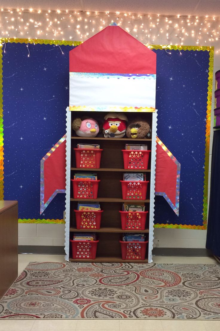 Space theme classroom.  Rocket bookshelf.