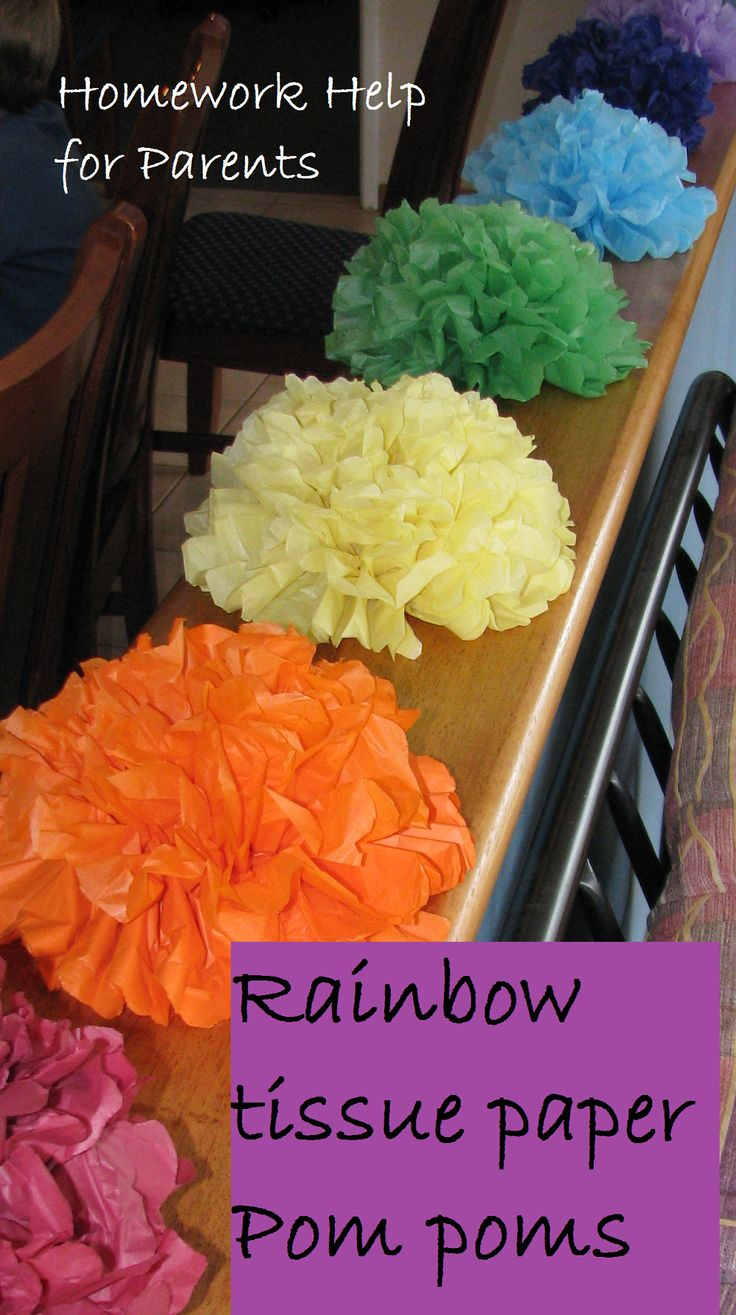 Tissue Paper Pom-poms - Take 8-10 layers of tissue paper. Fold like a fan. Tie in the middle. Separate layers to make pom-poms.