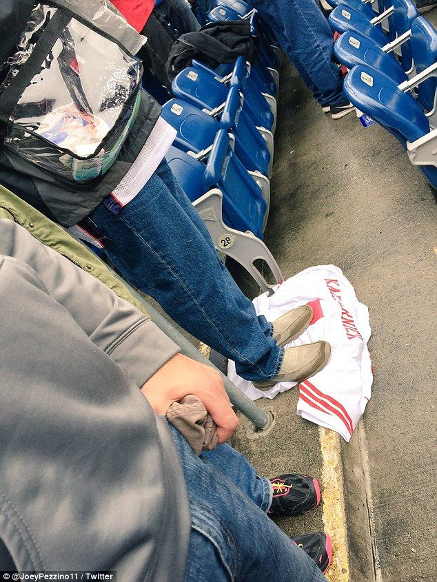 A Patriots fan stepped on a Colin Kaepernick jersey Sunday (pictured) during a game between the New England Patriots and the Buffalo Bills in Foxborough, Massachusetts