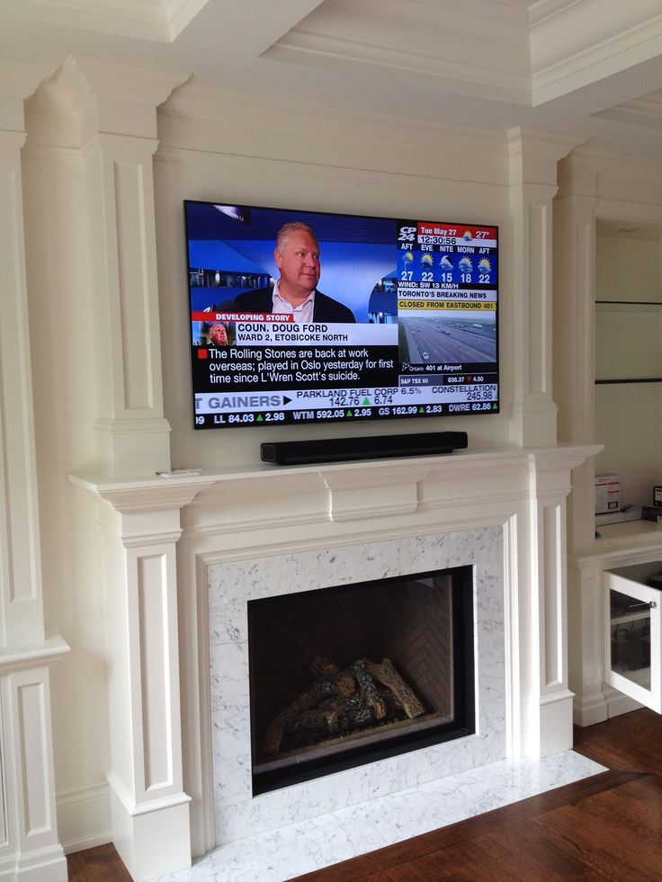 """SONOS Playbar with 65"""" Samsung TV above fireplace                                                                                                                                                                                 More"""