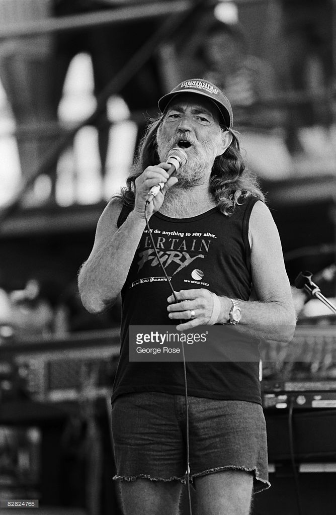 Singer Willie Nelson performs at the 1986 Manor, Texas, Farm Aid II concert. The fundraising concert, organized by Nelson and John Mellencamp, was held in Manor, Texas, located just north of Austin.