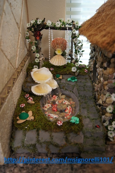 In the fairy garden the miniature koi pond with seashell waterfall should be finished! Included the clay frog and turtles. See it being built at http://pinterest.com/msignorelli101/my-homemade-fairy-garden/