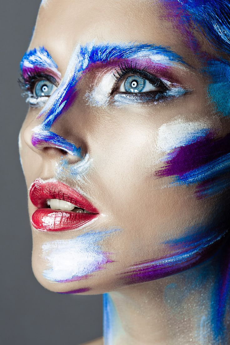 Artistic makeup - brush strokes. makes her look very much like a painting,