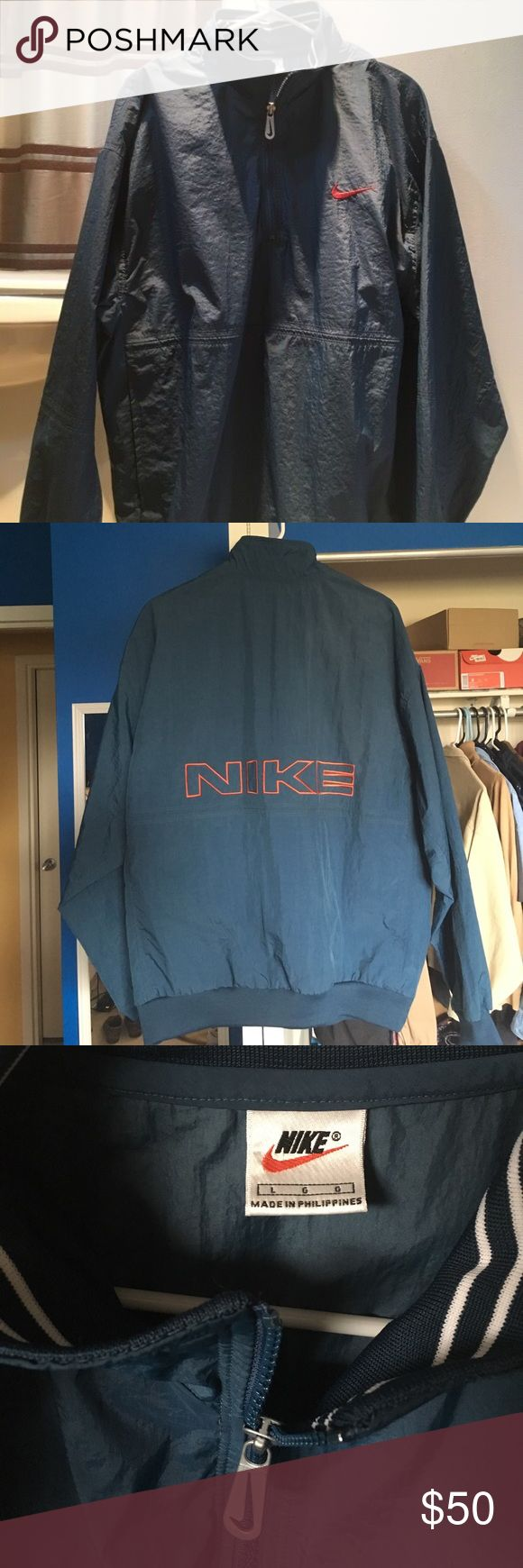 Vintage Turquoise Nike Pullover Windbreaker Jacket Vintage Nike turquoise blue, with dark red accents on the swoosh and back letters. Has a kangaroo hoodie pooch (side pockets). Perfect condition: no holes, rips, or tears. Just some wrinkles as seen in the photos. Size: Large Nike Jackets & Coats Windbreakers