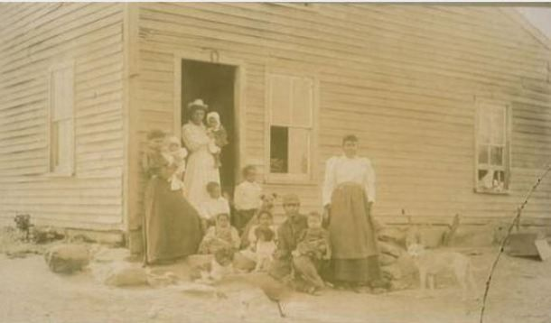 African American family in front of Abolitionist John Brown's old home, Torrington, Connecticut- (Connecticut Historical Society)