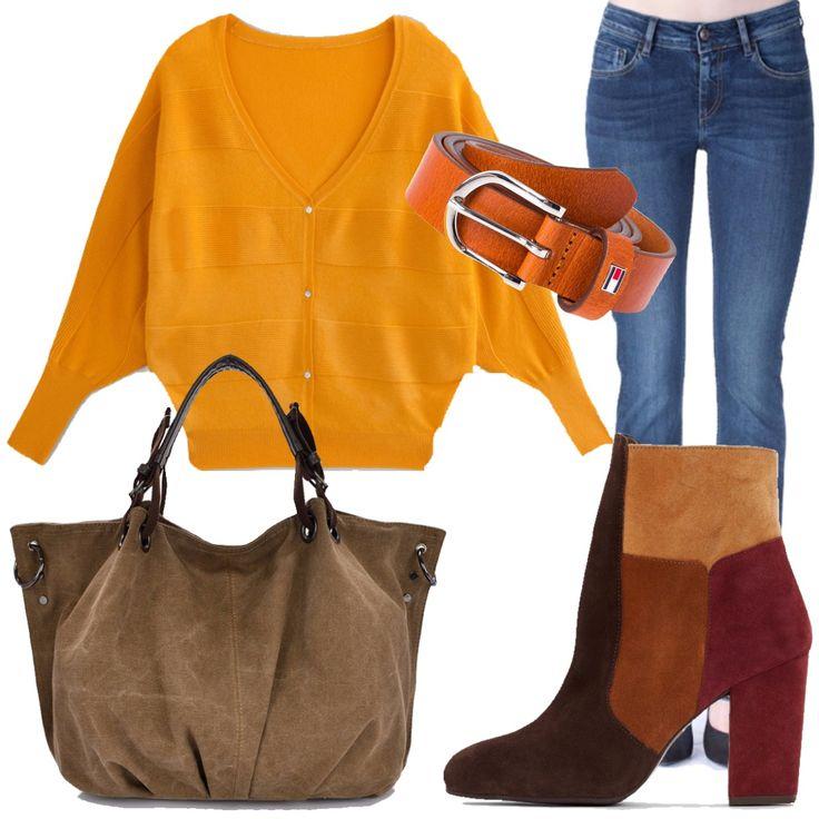 I colori caldi dell'autunno sono tutti in questo outfit. Il gilet con bottoni e maniche a pipistrello, con splendida scollatura a V, è abbinato al jeans dritto e agli stivaletti scamosciati multicolor. La cintura che ho scelto è di un caldo color arancio. La borsa vintage in tela color cammello rende il nostro abbigliamento ricercato. Adatto all'ufficio e all'appuntamento pomeridiano con le amiche.