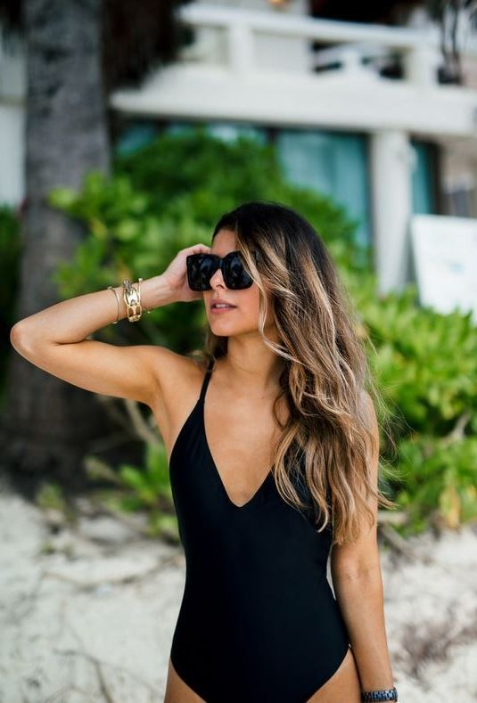 This simple black one piece swimsuit is so cute!