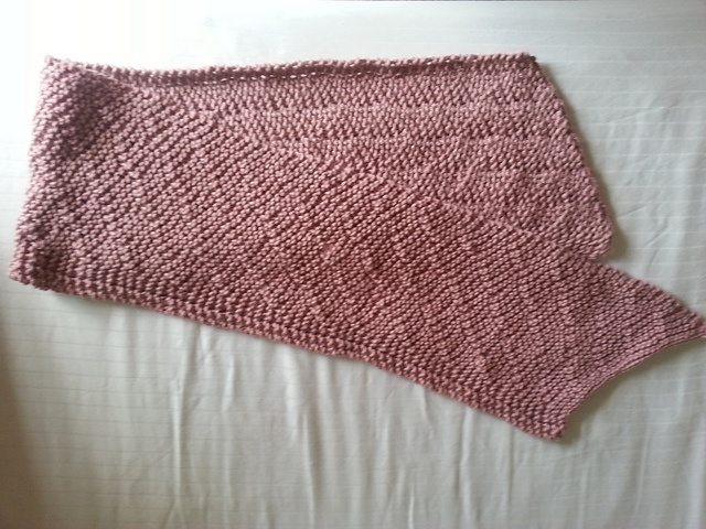 Here is a pretty pink version of the Whistle Down Scarf knit by Ravelry user Katey5678.