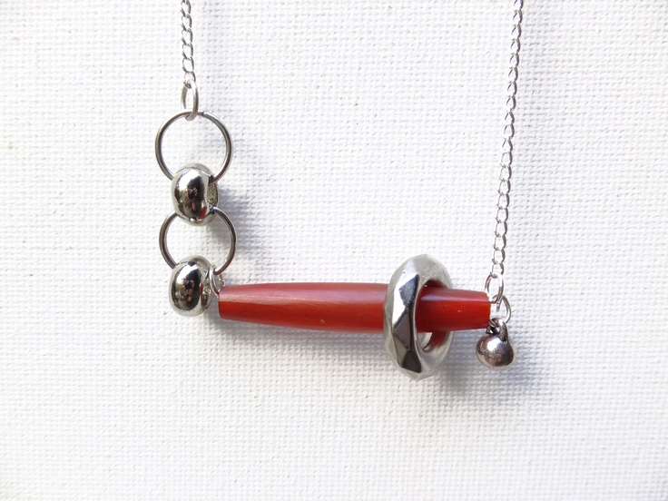 Asymmetrical necklace with red wooden bead and silver rings. Now available through my website www.eklecticmix.com.au