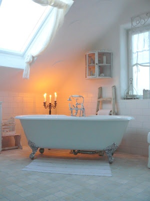 sky light above the clawfoot bath allows you to take your time in the bathroom & follow the stars when bathing in your tub