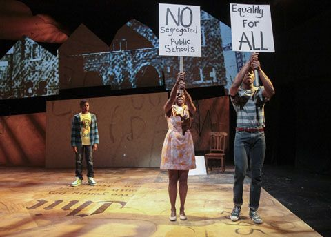 13-year-old Cameron A. Goode (left) plays Jabari, whose dreams take him back to 1963 Birmingham, Alabama to meet members of the Birmingham Children's Brigade (Leslie Ann Sheppard and Patrick Agada) in Chicago Children's Theatre's world premiere of Jabari Dreams of Freedom by Nambi E. Kelley. Performances are April 5-May 1 at the Ruth Page Center for the Arts, 1016 N. Dearborn St., Chicago. (Note: Cameron A. Goode alternates with another 13-year-old, Philip Cusic, as the title character in…