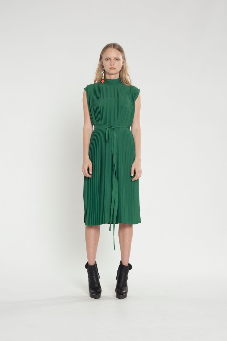 This pleated tunic is an edgy and easy piece featuring buttons and loops at the side seams, this piece can easily transform from a tunic to an evening dress. #fashion #dress #tunic #pleats #edgy #green