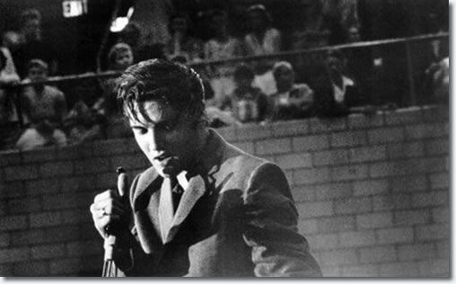 DJ Fontana and Elvis Presley and fans between shows in the fieldhouse - May 27, 1956