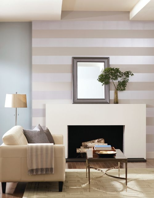Minimalist from metallics. Wide, even sized stripes add a formal flair to this clean-lined and serene living room. Add shimmer and style by accenting a wall with a specialty finish paint like a metallic silver. Add interest easily: tape, paint and achieve precise lines of pretty on any wall