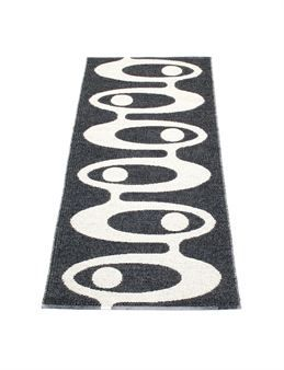 Alve is a smart and stylish black and white plastic woven rug  from the Swedish company Pappelina. It is available in four sizes.
