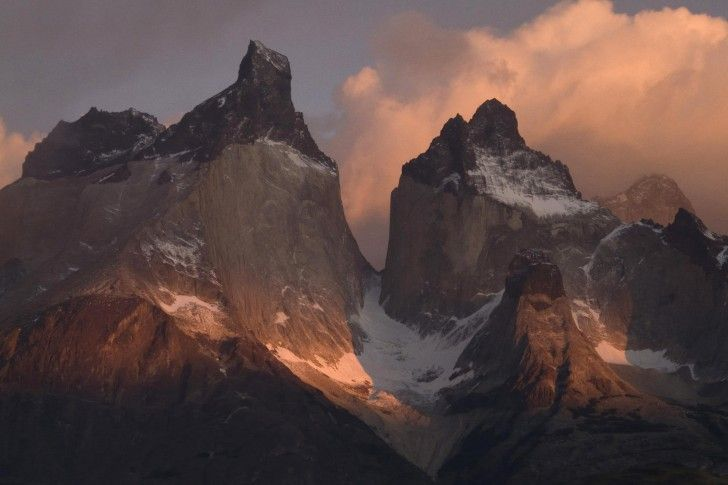 Torres del Paine is a national park located in south Patagonia, Chile. The park is known for its immense rock towers and peaks, part of the Andes mountain range