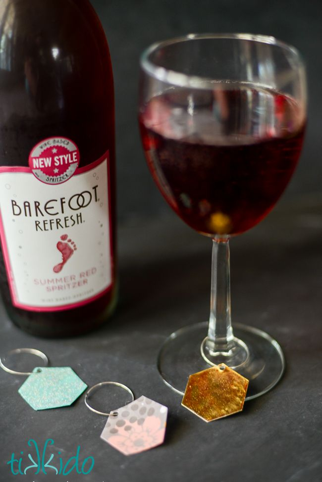I made these pretty, reusable wine charms out of scrapbook paper and gel nail polish!  Perfect for claiming my glass of Barefoot Refresh spritzer. It's Spritzer Season!  AD. Content for 21+