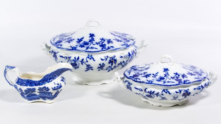 Lot 803: Flow Blue China Assortment; Two covered casseroles; together with a transferware gravy boat; together with a fish knife and fork set, mother of pearl and sterling silver ferrel serving pieces and silverplate serving utensils
