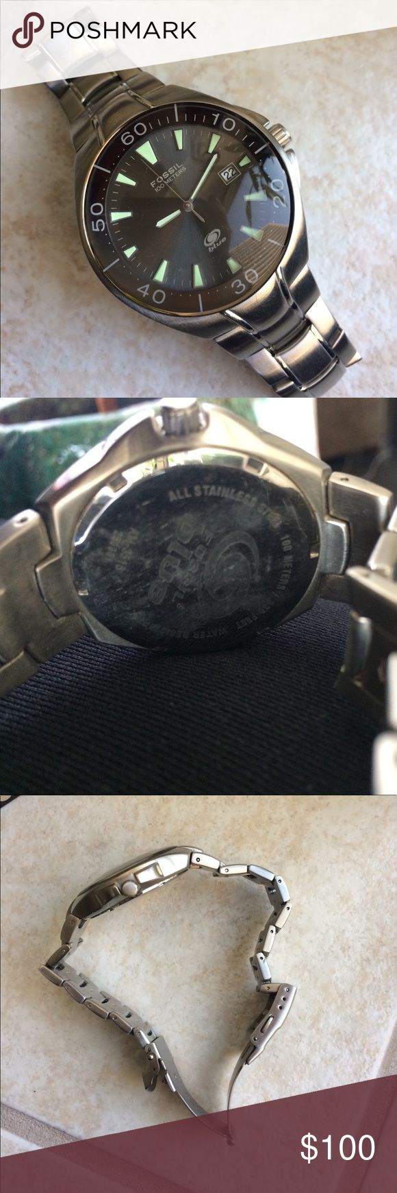 Men's Fossil Blue watch Good condition, a few tiny scratches on the face (too small to be seen in pics). No links have been removed from original size. Might need new battery, usually Fossil stores will do this for free. I can't really tell if the face is black or dark dark brown. Glows brightly in the dark Fossil Accessories Watches
