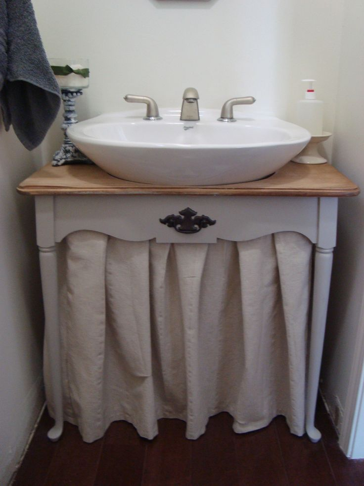 KNEW it could be done... this is a pedestal sink!  Don't like the curtain, but could do w/cabinet w/doors just as easily!