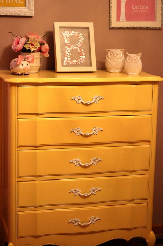 This painted yellow vintage dresser is the perfect pop of color (and sophistication!) in this chic nursery! #nurseryButton Art, Yellow Dressers, Vintage Dressers, Exactly Dressers, Buttons Art, Provincial Dressers, French Provincial Dresser, Projects Nurseries, Frames Buttons
