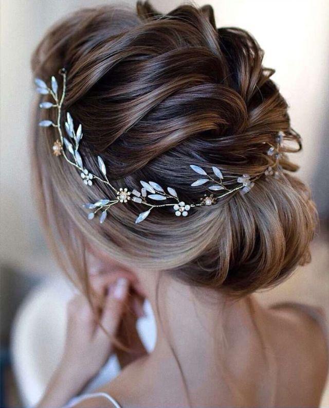 Romantic Bridal Hairstyle Idea Low Bun With A Delicate Hairpiece Loose French Braid Hairstyles For Bridal Hair Wreath Hair Vine Wedding Wedding Hair Wreath