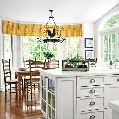 Kitchen island. Love the rooster light.
