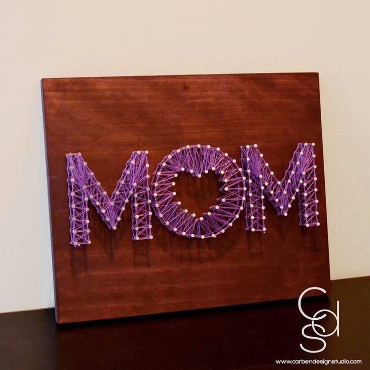 """Mother's Day is less then 2 weeks away! If you're looking for a unique gift for a special Mom in your life, check out our """"Mom"""" String Art!  Each piece is hand stained, nailed and strung with the embroidery color of your choice! Truly a one of a kind gift for a one of a kind Mom!  Available for $35 on Carbendesignstudio.com or sales@carbedesignstudio.com!"""