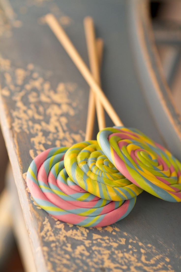Faux lollipop for room decor or cute photography prop without the sticky mess.  Use a polymer modeling clay (like Fimo) and a wooden dowel, then bake til hard.  Use non-toxic clay, cause your little one will definitely put these in their mouth!