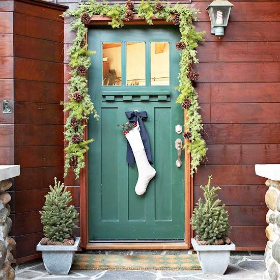 Create Fun Holiday Accents  Frame a stuffed stocking with a simple over-the-door garland to add an interesting touch to classic Christmas door decorations. Stuff a plain stocking with berries, evergreen, and small pinecones, then hang it with ribbon from the middle of the front door.