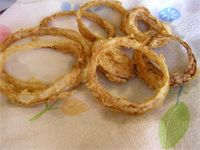 Gluten free Onion Rings -  I used tapioca flour and garbanzo and fava bean flour.  Exactly the way I like them - a little flaky crust and yummy!  The kids are asking for more to be made.
