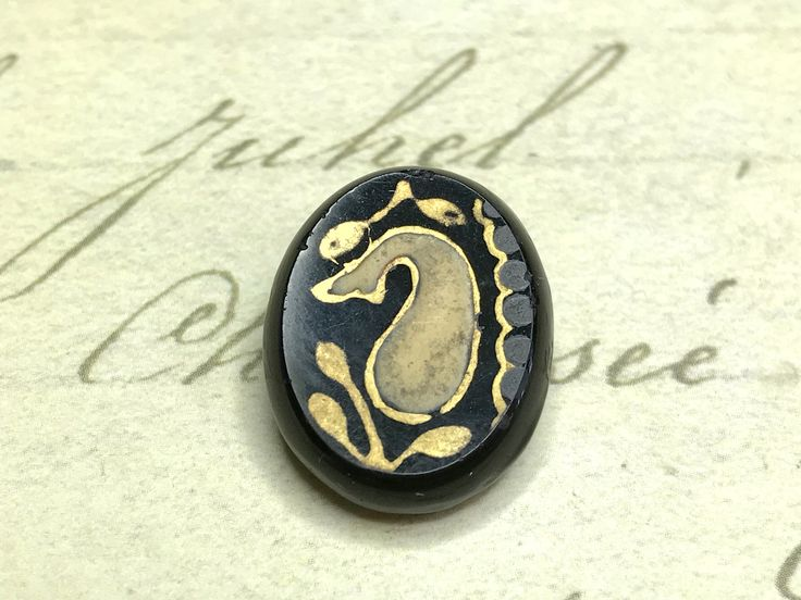 Small Jet Black Glass Paisley Picture Button 14 mm by GwensButtons on Etsy https://www.etsy.com/ca/listing/539725803/small-jet-black-glass-paisley-picture