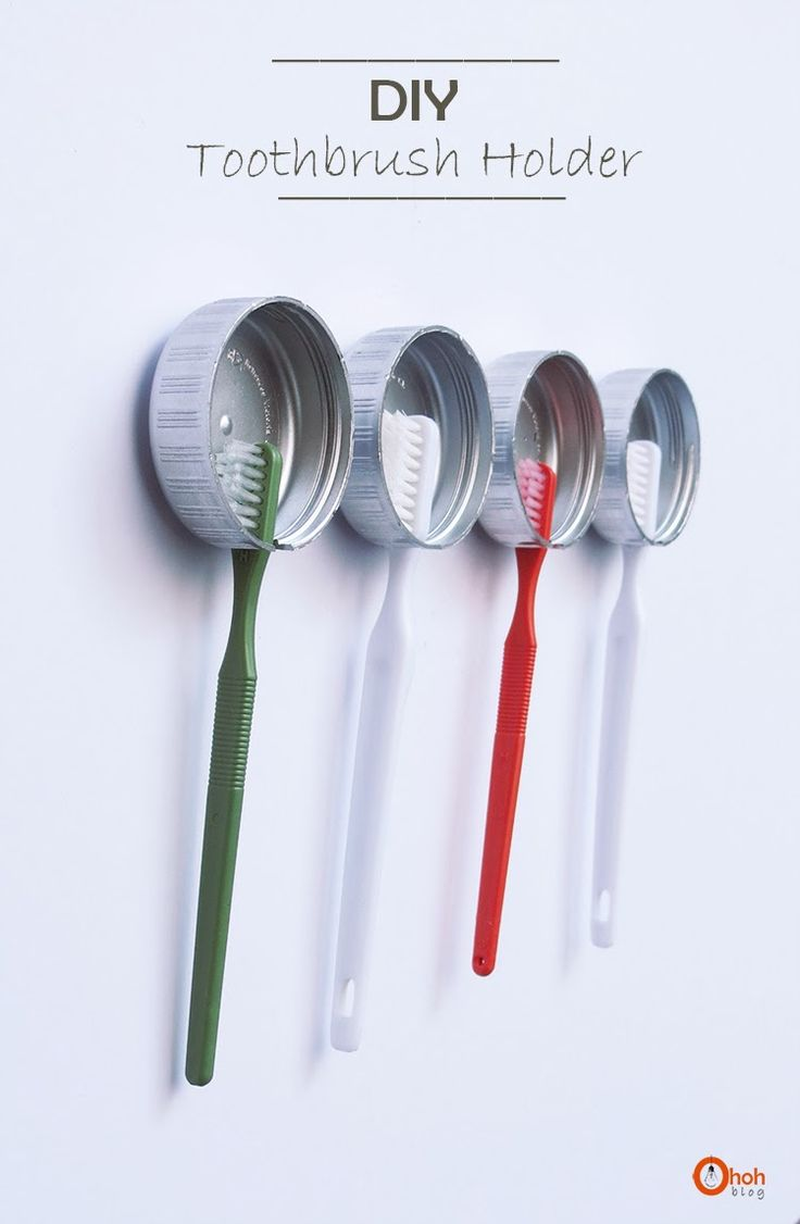 DIY Toothbrush Holder - cut a notch out of a plastic bottle cap and mount to your wall with two pieces of velcro. silver spray paint optional.