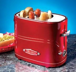 """Retro Red Hot Dog Toaster  Product #: EM600  Price: $39.98        Hot Dog Toaster is a real """"wiener""""! Place 2 dogs and 2 buns into the special slots and push the button down. When they're perfectly done, they'll pop up to let you know! 3 ft. cord. (9""""L x 8""""H x 5""""W) http://katherinel.shopregal.ca"""