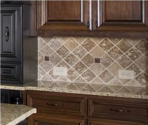 This kitchen backsplash uses light and dark brown tiles to compliment the dark brown cabinets.