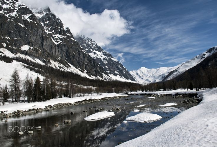 Val Ferret in spring - panorama of the Val Ferret in the spring, with the mountains that are reflected in the river