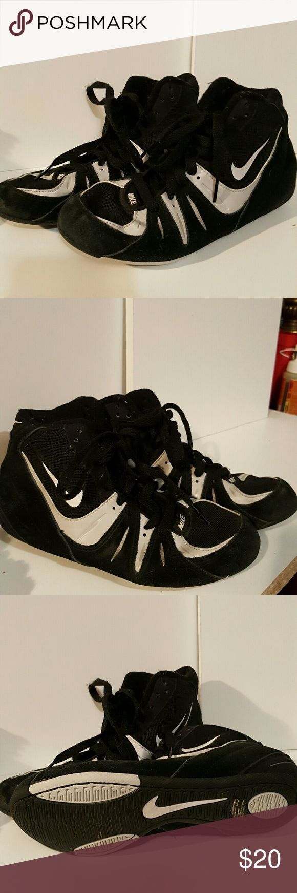 Nike wrestling shoes size boys 4.5 Uses, good condition,  stretched out. Not for a thin foot. Nike Shoes