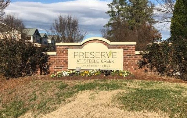 JC Signs Charlotte was chosen to replace the Sign on this Brick Base for The Preserve at Steele Creek. The new HDU Sign is Custom Painted and displays the Company Logo Design! #customsigns #signscharlotte #monumentsigns #monumentsignscharlotte