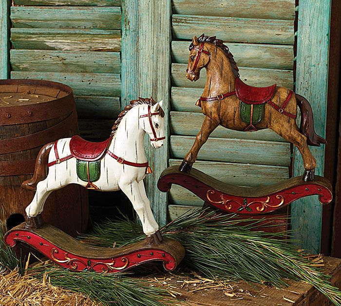 "#burtonandburton Hand-painted and raised resin design horses. One white and one brown each with red saddles and green blankets standing on brown rockers. Rockers are accented in red with gold scroll and green holly. Distress marks on horses. Individual in white gift boxes.<br><br>12 1/2""H X 12""W X 2 1/2""D<br>2 assortments of 2."