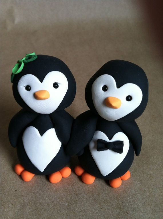 These are adorable!  Penguin love Wedding Cake Topper by LuLuAmour on Etsy