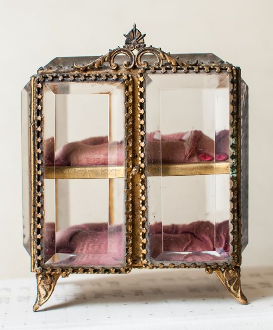 """Rare Antique French Crystal Casket Box Stunning c. 1900 French crystal footed casket box. I've never seen one like this before with double doors and two shelves. This exquisite piece has thick beveled glass and tufted silk shelves. Fraying to the fabric adds to the old world charm. The doors of the box open by pulling them toward you.  This measures 4-3/4"""" tall, 4"""" wide, 3"""" deep. A lovely piece!"""